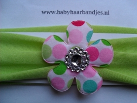 Groene baby haarband met stippen bloem.