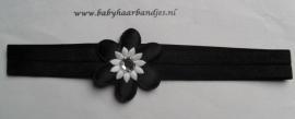 Smalle zwarte baby haarband met bloemetje.