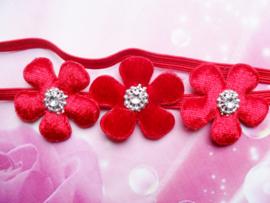 Super smal rood baby haarbandje met 3 bloemetjes.