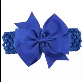 Gehaakte donker blauwe haarband met strik.