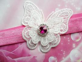 Smalle donker roze baby haarband met vlinder.