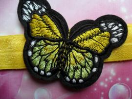 Smalle gele baby haarband met vlinder.