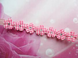 Voor de allerkleinste super smal roze haarbandje met mini bloemetjes.