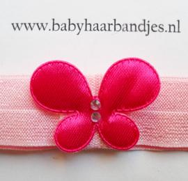 Voor de allerkleinste roze haarbandje met vlindertje.
