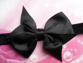 Smalle zwart baby haarband met stik.