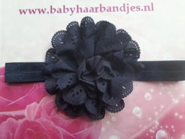 Smal donker blauw baby haarbandje met kanten bloem.