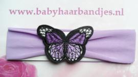 Paarse baby haarband met vlinder.