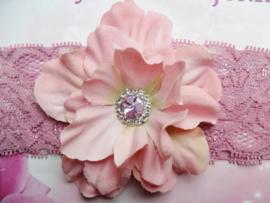 Kanten oud-roze baby haarband met bloem .