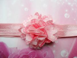 Smalle roze baby haarband met stippel toefje.