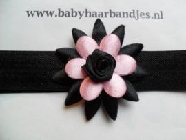 Smalle zwarte baby haarband met zwart/roze puntbloem.