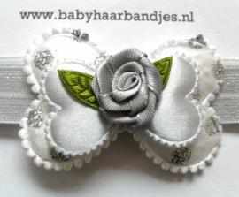 Smalle grijze baby haarband met strikje.