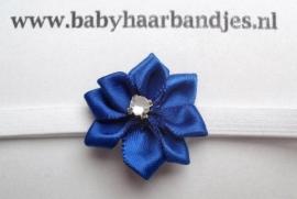 Voor de allerkleinste super smal wit haarbandje met donker blauw bloemetje.