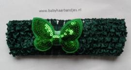 Gehaakte donker groene haarband met glitter vlindertje.