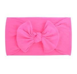 Super zachte donker roze nylon baby haarband met strikje.