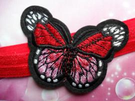 Smalle rode baby haarband met vlinder.
