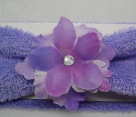 Super zachte paarse haarband met bloem.
