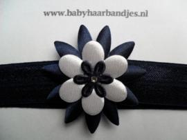 Smalle donker blauwe baby haarband met puntbloem.