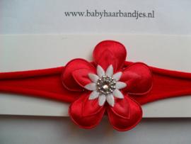 Voor de allerkleinste rood nylon haarbandje met bloem.