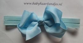 Voor de allerkleinste blauw haarbandje met strik.