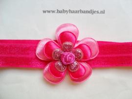 Smalle fuchsia baby haarband met bloemen.