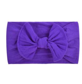 Super zachte paarse nylon baby haarbandje met  strikje.