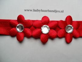 Voor de allerkleinste rood haarbandje met bloemetjes.