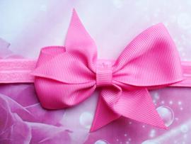 Smalle donker roze haarband met strik.