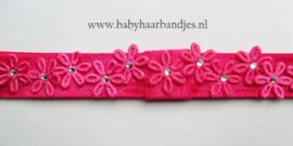 Smalle donker roze baby haarband met bloemetjes.