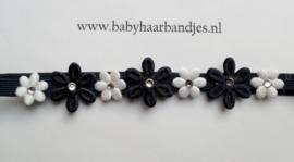 Super smal donker blauw baby haarbandje met bloemetjes.