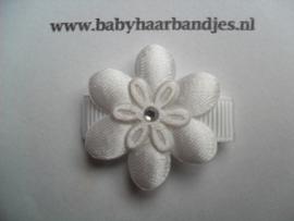 Lok speldje wit bloemetje.