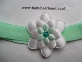 Voor de allerkleinste groen glitter haarbandje met bloem.