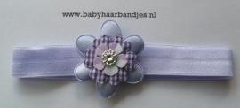 Voor de allerkleinste lila baby haarbandje met bloem.