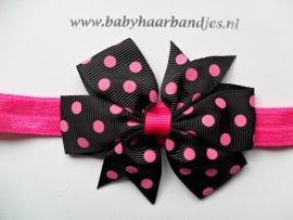 Smalle fuchsia baby haarband met stippen strik.