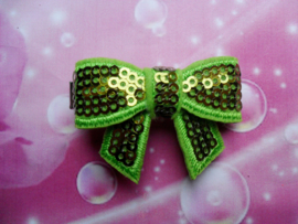 Alligator clipje met grasgroene glitter strik.