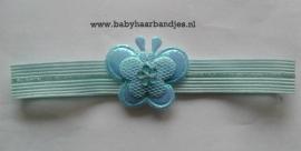 Voor de allerkleinste blauw haarbandje met vlindertje.