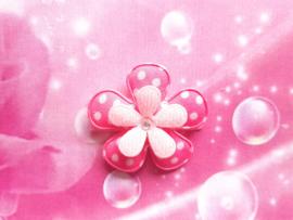 Lok speldje roze stippel bloem.
