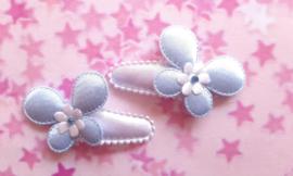 3 cm wit haar knipje met blauwe vlindertjes.