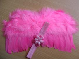 Roze baby engelen vleugels met bijpassende hoofdband.