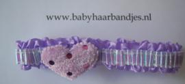 Voor de allerkleinste paars roezel haarbandje met hartje.