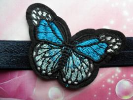 Smalle donker blauwe baby haarband met  vlinder.