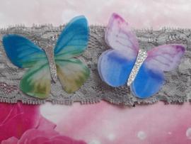 Grijze kantenbaby haarband met vlinders.