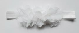 Smalle witte baby haarband met  bloemetjes.
