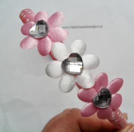 Diadeem roze met bloemetjes en hartjes.
