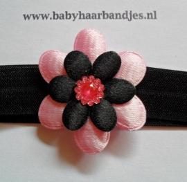 Smalle zwarte baby haarband met roze/zwarte bloem.