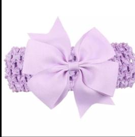 Gehaakte lila haarband met strik.