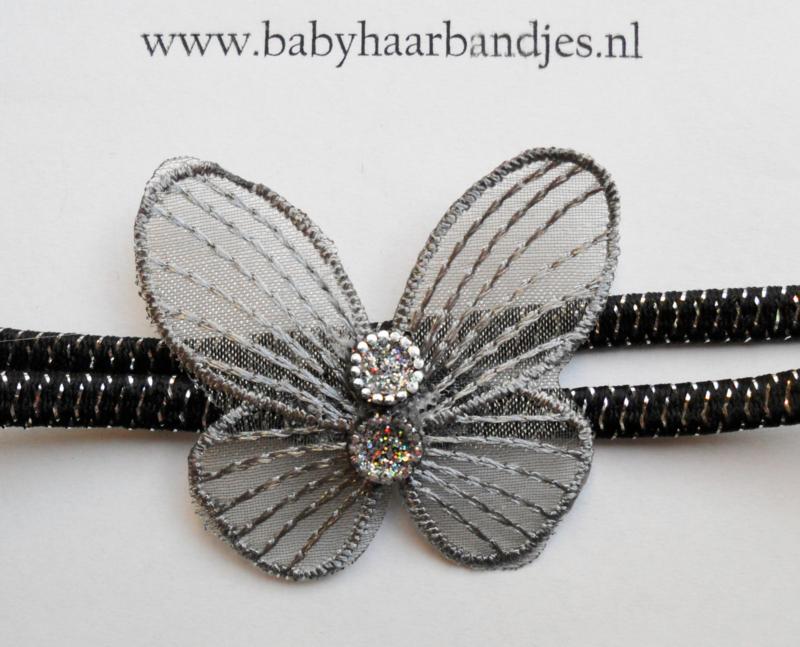 Super smal zwart/zilver baby haarbandje met vlindertje.