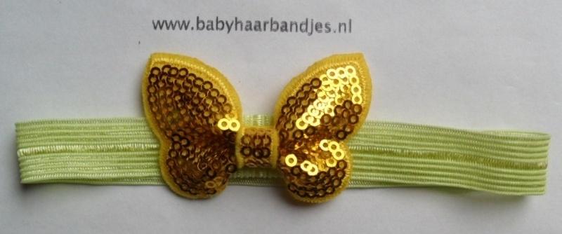 Voor de allerkleinste geel haarbandje met glitter vlindertje.