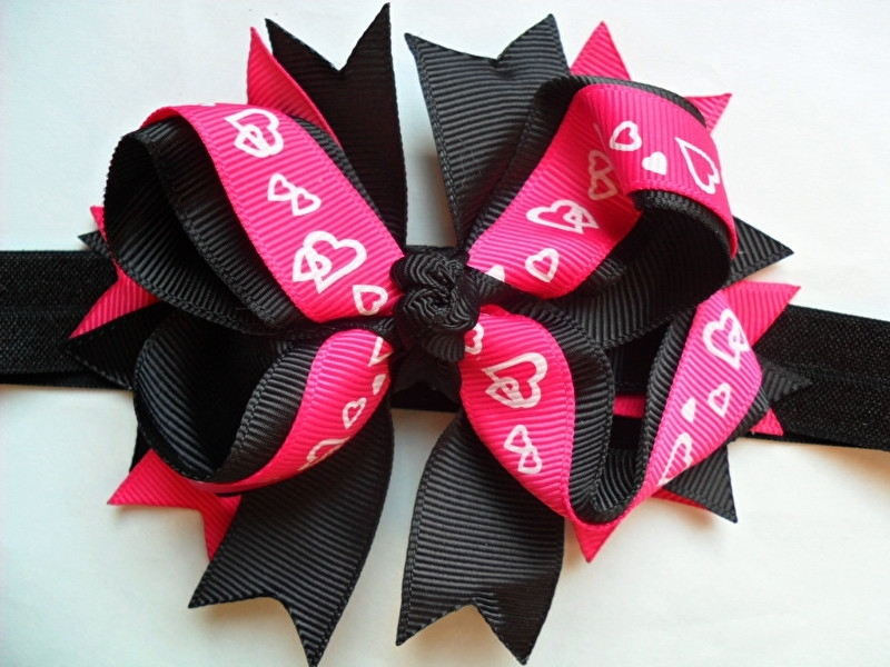 Smalle zwarte baby haarband met grote boutique bow.