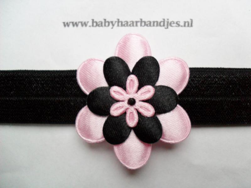 Smalle zwarte baby haarband met zwart/roze bloemen.