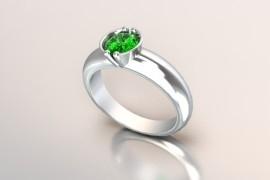 Witgouden 14k solitair met een ronde kast en een smaragd kleur Swarovski zirkonia 1403003